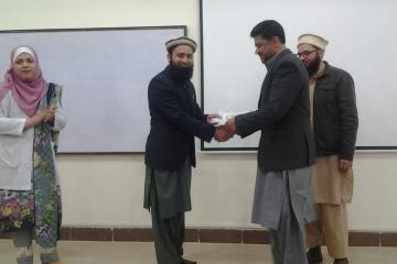 Dr Asif presenting to Dr Zafar