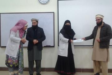 Dr Hamid presenting to Dr Aqsa