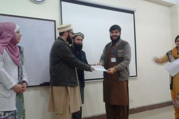 Dr Hamid presenting to Dr Ibrar