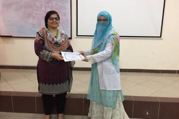 Participant receiving Certificate from Dr. Zilli Huma.